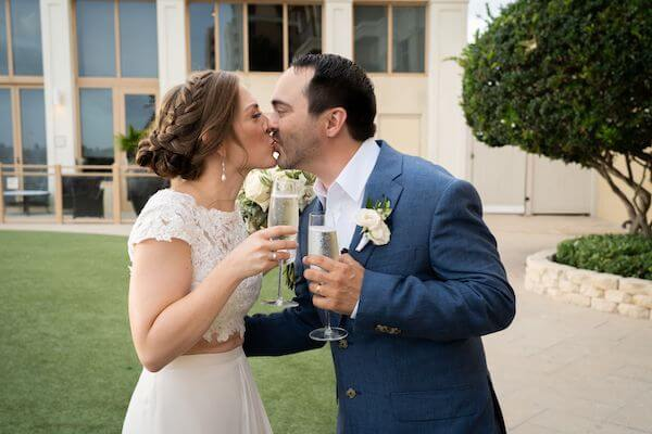 newlywed couple kissing after their Clearwater beach wedding