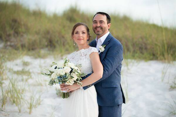 bride and groom posing for wedding photos on Clearwater Beach