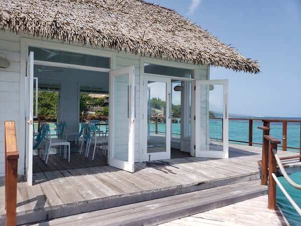 Sandals overwater wedding chapel with thatched roof and large French doors