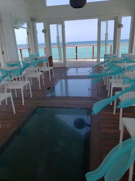 glass panels in the floor of the overwater wedding chapel