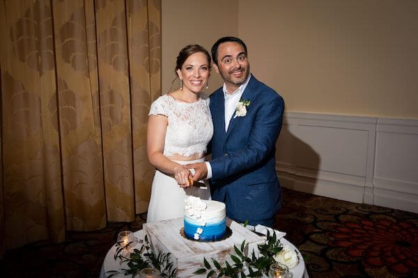 bride and groom cutting an intimate blue and white ombre wedding cake