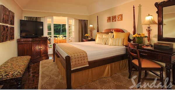 bed room at the Sandals Ochi Beach Club Resort