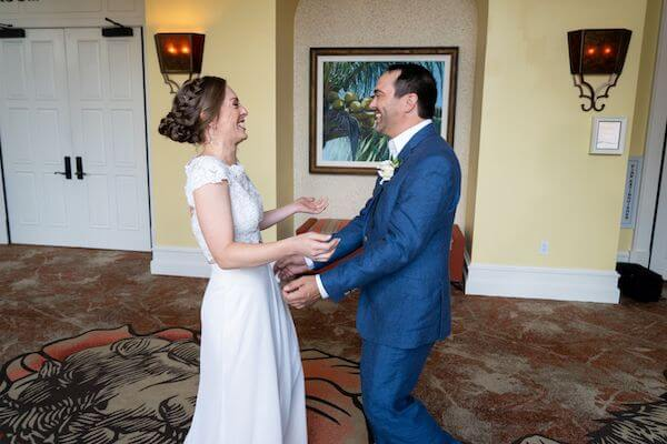 engaged couple's first look before their Clearwater Beach wedding