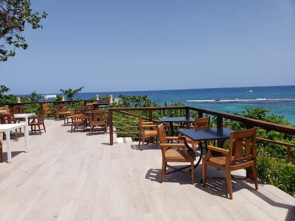Deck overlooking the tropical waters at Sandals Ochi Beach Club