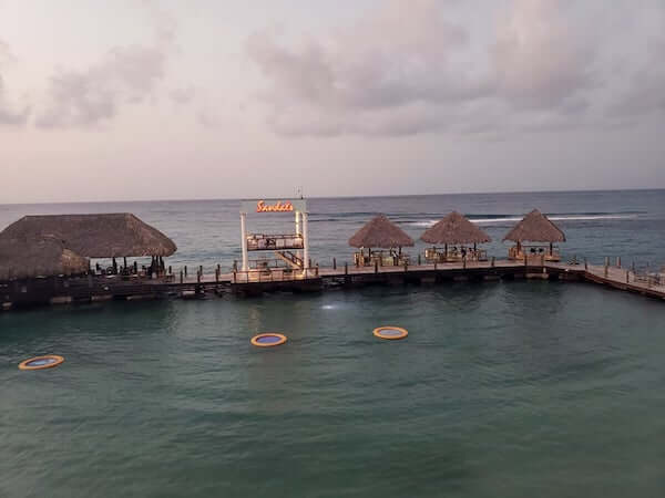 Waterfront cocktail huts at Sandals Ochi Beach Club