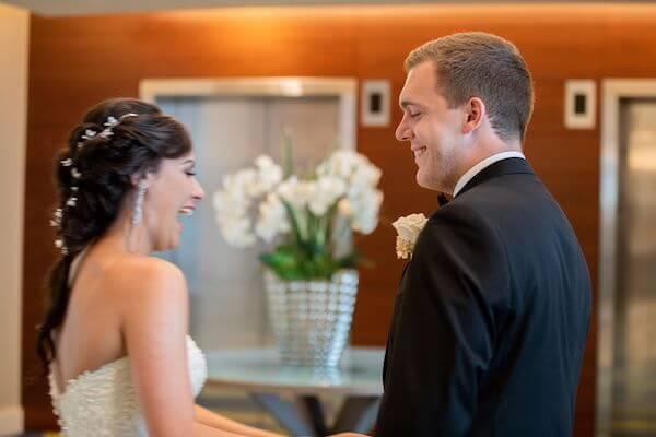 bride and groom laughing after having their first look