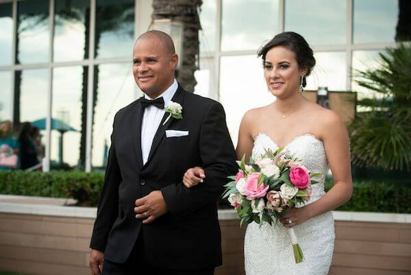 Father walking his daughter down the aisle at her Clearwater Beach wedding ceremony