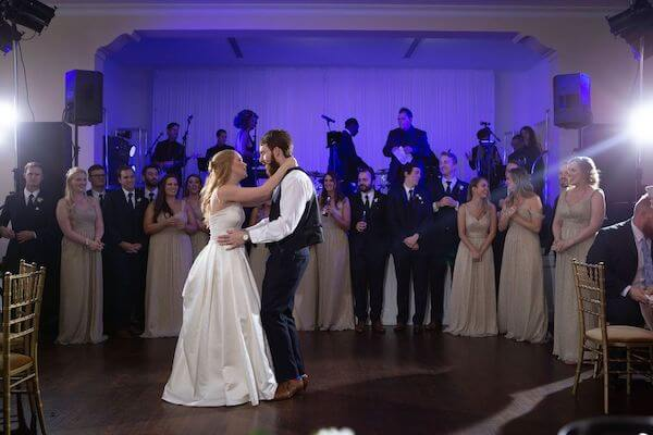 Wedding band on stage as newlyweds have their first dance