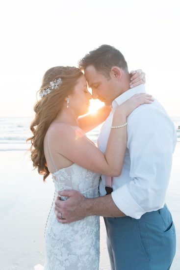 bride and groom on Clearwater Beach at sunset