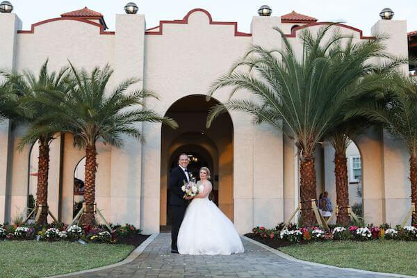 bride and groom in front of Dunedin's iconic Fenway Hotel