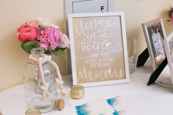 a couple chose a message in a bottle instead of a guest book for their beach themed wedding