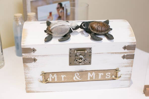 a box for wedding cards decorated with bride and groom sea turtles for a beach themed wedding