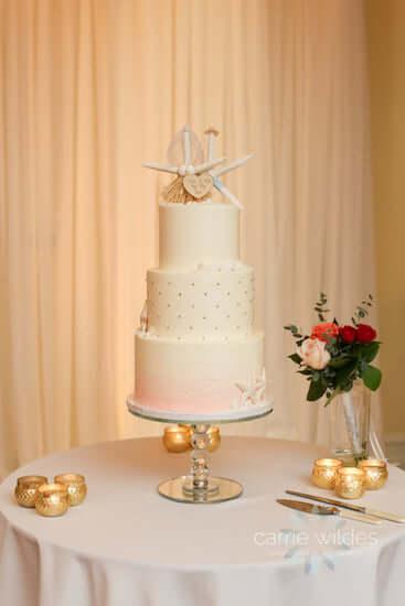 four tiered beach themed wedding cake