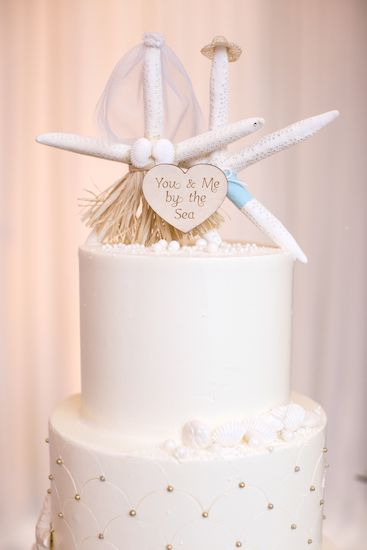 bride and groom starfish for a beach themed wedding