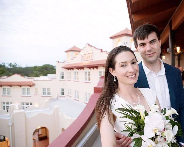 Bride and groom at the rooftop bar at the Fenway Hotel in Dunedin