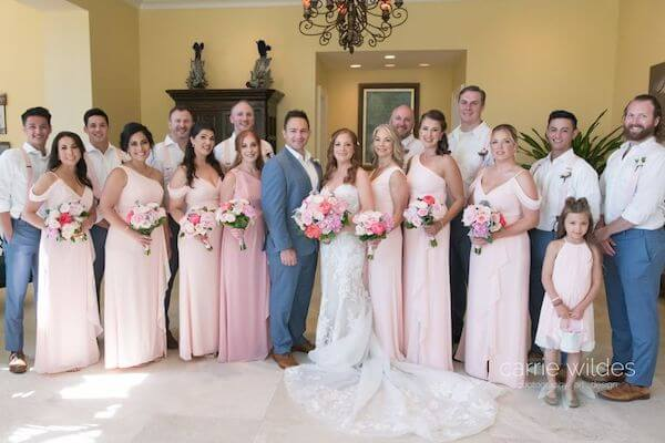 bride and groom with their wedding party at the Sandpearl Resort on Clearwater Beach