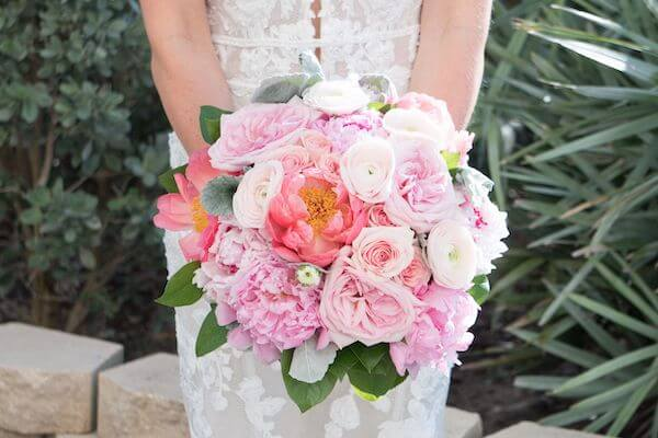 Pink bridal bouquet with peonies, roses and ranunculus