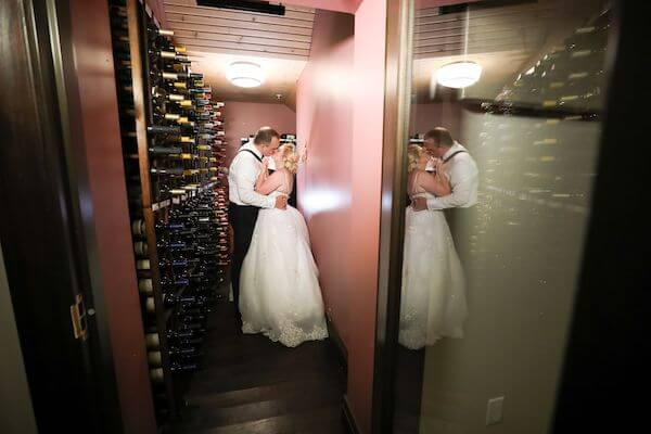 bride and groom in the wine cellar of the Fenway Hotel