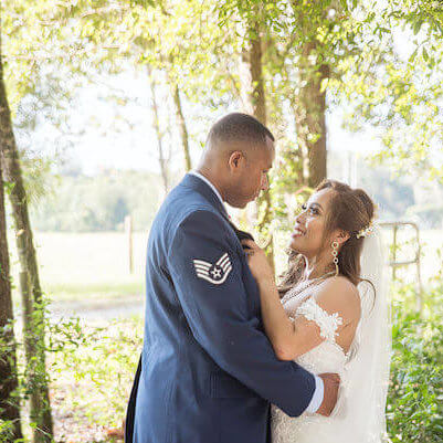 Special Moments Event Planning - Tampa Bay wedding - Secret Garden Wedding - 911 wedding - Military couple - bride and groom - Groom in Air Force uniform - first look